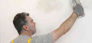 Contractor spackling walls